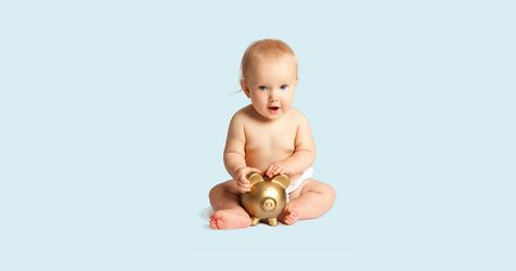 A baby with a gold piggy bank